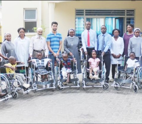 A group photo of the children recipients of wheelchairs, parents, Management of Cardinal Distributors , Sisters and Members of staff of the Zambia Italian Hospital