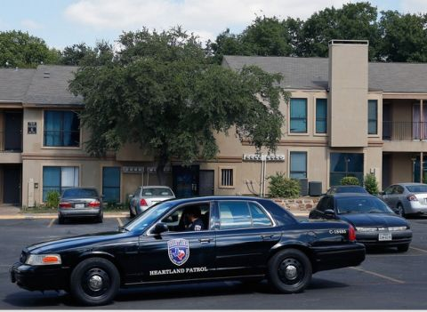 A private security guard patrols the apartment building in Dallas where Ebola patient Thomas Duncan stayed. The family that hosted him is quarantined.