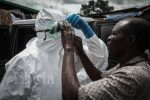 Adjusting a pair of protective goggles before the burial team sets off - Ebola crisis in Liberia