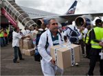 Cuban doctors and health workers arrive at Freetown's airport to help the fight against Ebola in Sierra Leone. Photograph: Florian Plaucheur/AFP/Getty Images