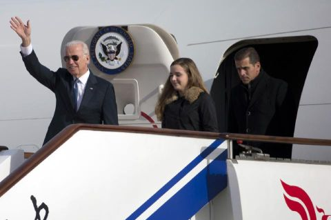 FILE - This Dec. 4, 2013, file photo shows U.S. Vice President Joe Biden, left, arriving on Air Force Two in Beijing, China, with his son Hunter Biden, right, and his granddaughter Finnegan Biden.