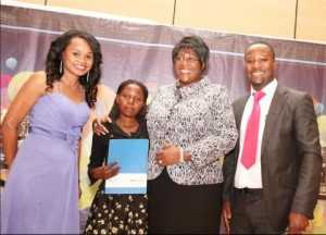 First Lady Dr Christine Kaseba presents the ABE Scholarship award to Purity Chitala to study Business management at ZCAS during the 2014 ZNBC: ZICTA Debate Time