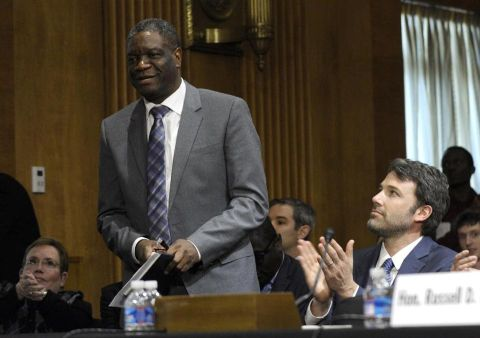 In this Wednesday, Feb. 26, 2014 file photo, actor and Eastern Congo Initiative Founder Ben Affleck, right, applauds Dr. Denis Mukwege, founder of Panzi Hospital in the Democratic Republican of the Congo, on Capitol Hill in Washington