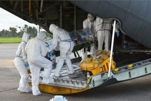 Medics load an Ebola patient onto a plane at Sierra Leone's Freetown-Lungi International Airport on Monday, September 22.