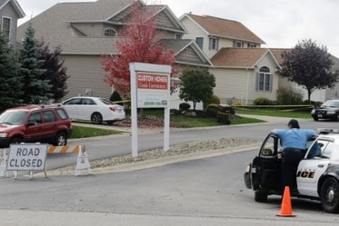 Police watch over a house on Thursday in Tallmadge, Ohio where Amber Vinson, the other US nurse to contract Ebola, stayed. Photograph: Tony Dejak/AP
