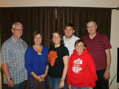Posed from left are Jeff and Gina Rittgers, Brooke and Jed Heubner, and Pam and Wally Heubner, who are all involved with the nonprofit Hands at Work in Africa supporting a program for orphans in Zambia, Africa.