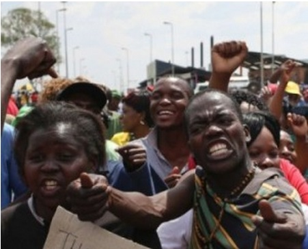 South Africans riot as fifth man arrested over rape and murder of girls in shantytown