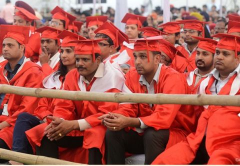 Students at Lovely Professional University in Punjab listen to Afghanistan President Hamid Karzai speak after receiving an honorary degree in 2013
