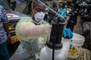 The team prepares to clean up after removing the bodies - Ebola crisis in Liberia
