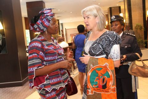 Vice-President Dr Guy Scott's wife Charlotte chats with FDD president Edith Nawakwi during the Golden Jubilee Luncheon at the Hotel InterContinental in Lusaka on October 24,2014 -Picture by THOMAS NSAMA