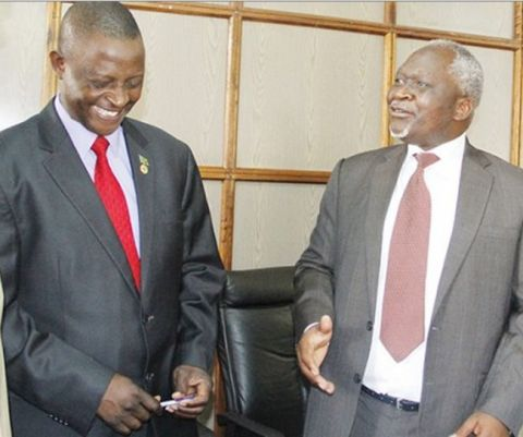 Zambia's Foreign Affairs Permanent Secretary George Zulu (right)