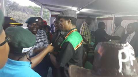 A cheerful Lungu greets MPS and Ministers in the VIP Podium