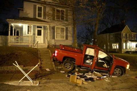 A vandalized truck sits in the front lawn of a house Tuesday, Nov. 25, 2014, in Ferguson, Mo