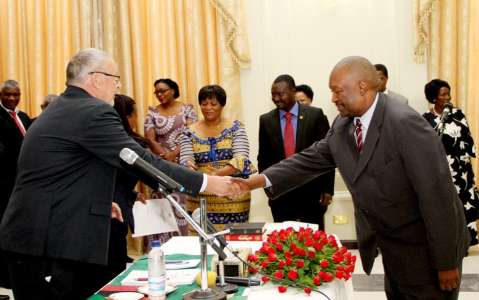Acting President Dr Guy Scott congratulates Justice Lishomwa Nawa Muuka during the swearing -in-ceremony of four High Court Judges on November 25,2014 -Picture by THOMAS NSAMA