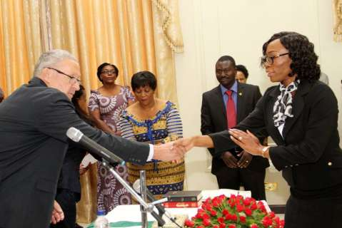 Acting President Dr Guy Scott congratulates during the swearing -in-ceremony at State House on November 25,2014 -Picture by THOMAS NSAMA