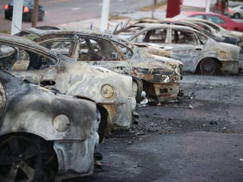 Cars which were set on fire when rioting erupted following the grand jury announcement in the Michael Brown case sit on a lot, Nov. 25, 2014 in Dellword Mo.