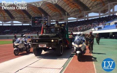 The body of Michael Sata enters the stadium