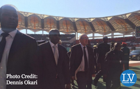 Acting President Dr. Guy Scott arrives at the National Heroes' Stadium