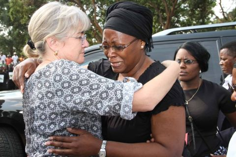 First Lady Dr Christine Kaseba being embraced by Acting President Dr Guy Scott's wife Charlotte on arrival at Lusaka Show grounds for the gathering to Celebrate President Sata's life on Nov 6,2014 -Picture by THOMAS NSAMA