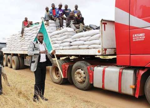 LUANO district commissioner Christopher Chibuye flagged off the first farmer input distribution at Coffee Farm in Mkushi last week. PICTURE- CHAMBO NG'UNI