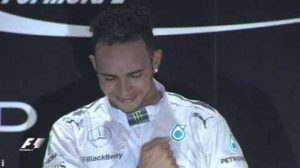 Lewis Hamilton strikes his chest on the podium as he reflects on what he has just achieved. The Briton, after six years of waiting, has another world title for his collection.
