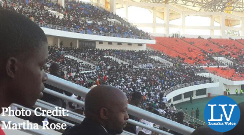 Crowds gather inside the National Heroes' Stadium