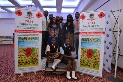 2014 Poppy Appeal - Winners of the School Poster Competition: The two girls in the front, Jenipher Nachimbi and Martha Mwakashela from Mukamambo 11 Girls Secondary School, were the winners and their poster was turned into the pull-up poster all the winners are standing beside
