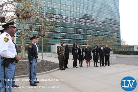 UN Security and Safety Service personnel and Zambian Diplomats to the UN pay tribute to the late President Michael Chilufya Sata during the lowering of the UN flag in New York on 11 November, 2014. PHOTO | CHIBAULA D. SILWAMBA | ZAMBIA UN MISSION