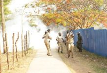 Zambia police officers run for their lives after UNZA monks ambushed them with stones UNZA Network