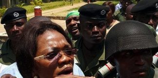 chairperson for Elections Sylvia Masebo escorted by armed police officers stormed Mulungushi Rock of Authority