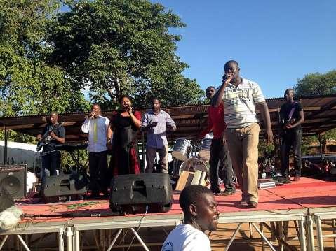 Mathew Ngosa singing at the rally