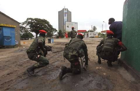 Congolese security officers position themselves
