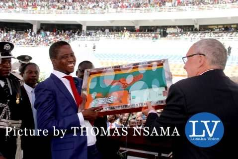 Former Acting President Dr Guy Scott handing over the instruments of Power to President Edgar Lungu during the Inauguration Ceremony at Heroes Stadium in Lusaka on January 25,2015 -Picture by THOMAS NSAMA - lusakavoice.com