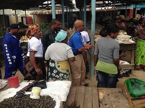Nevers Mumba Walking about the market  at Solwezi Market