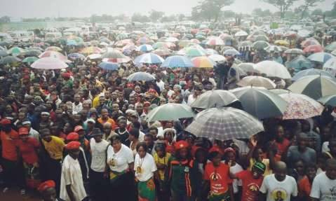 People of Woodlands, Nyumba yanga, Chilenje and surrounding areas brave the rains to listen to Hope and Help