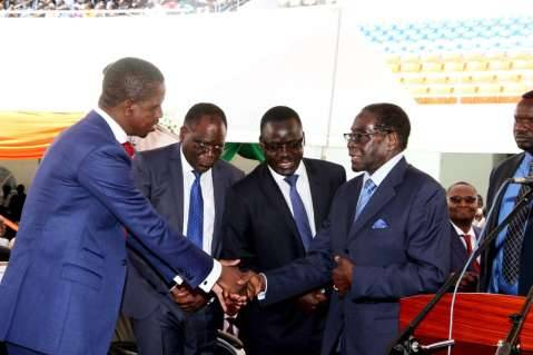 President Edgar Lungu with Zimbabwe's President Robert Mugabe during his Inauguration Ceremony at Heroes Stadium in Lusaka on January 25,2015 -Picture by THOMAS NSAMA
