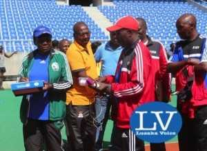 Ndola bases Referees instructor Bernarch Chabala in  a red track suit briefing FAZ Referee Committee Chairman Jeff Chipilingo  (in yellow golf T shirt)!    - Photo Credit Jean Mandela - Lusakavoice.com