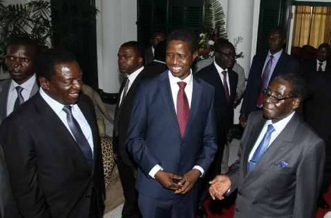 President Edgar Chagwa Lungu (centre) with his Zimbabwean counterpart Robert Mugabe (right) and Vice President Emmerson Mnangagwa at State House in Harare,Zimbabwe on Friday,February 6,2015. PICTURE BY SALIM HENRY:STATE HOUSE