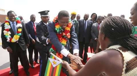 President Edgar Chagwa Lungu greets traditional dancers on arrival at Harare International Airport in Zimbabwe on February 6,2015 -Picture by EDDIE MWANALEZA :STATE HOUSE