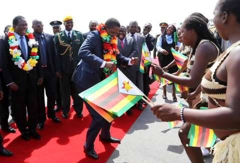 President Edgar Chagwa Lungu join traditional dancers on arrival at Harare International Airport in Zimbabwe on February 6,2015 -Picture by EDDIE MWANALEZA :STATE HOUSE