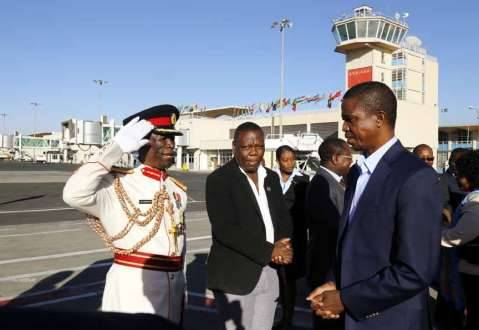 President Edgar Chagwa Lungu (right) being saluted by Mukuka Chipopola a defence attache at Zambian Embassy in Ethiopia at Bole International Airport in Ethiopia on Sunday,February 1,2015. PICTURE BY SALIM HENRY:STATE HOUSE