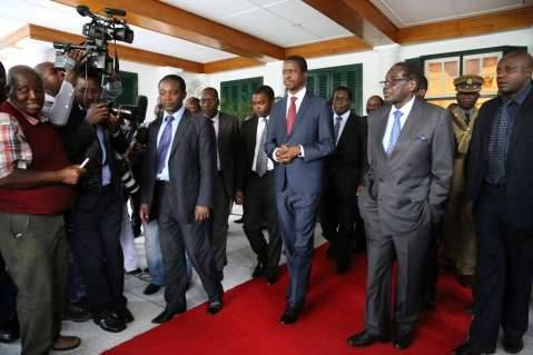 President Edgar Chagwa Lungu with his Zimbabwean counterpart Robert Mugabe at State House in Harare,Zimbabwe on Friday,February 6,2015. PICTURE BY EDDIE MWANALEZA/STATE HOUSE