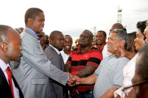 President Edgar Lungu being welcomed by Agriculture minister Given Lubinda on arrival fro Angola at Kenneth Kaunda International Airport Picture by THOMAS NSAMA
