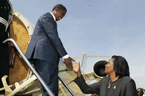 President Edgar Lungu being welcomed by Zambia's High Commissioner to Zimbabwe Ndiyoyi Mutiti on arrival at Harare International Airport on February 6,2015 -Picture by SALIM HENRY