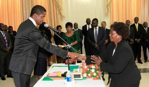 President Edgar Lungu congratulates newly appointed Senior Private Secretary in the Office of the Vice-President Ambassador Sheila Siwale during the swearing-in- ceremony at State house on Thursday, 19th February 2015 - Picture