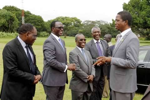 President Edgar Lungu speaks with Secretary to the Cabinet Dr Roland Msiska (l), Information Permanent Secretary Chanda Kasolo (Second from left), Senior Private Secretaries Geshiom Siame (third from left) and Ogeon Gondwe
