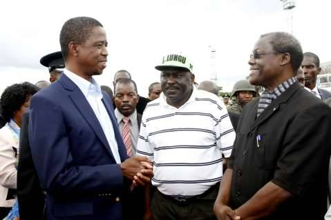 President Edgar Lungu with PF Secretary General Davies Chama and Justice Ngosa Simbyakula on arrival at Kenneth Kaunda International Airport on February 1,2015 -Picture by THOMAS NSAMA