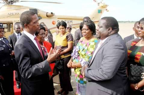 President Lungu talks Information minister Chishimba Kambwili shortly before departure at Kenneth Kaunda International Airport for Angola on February 13,2015 -Picture by THOMAS NSAMA