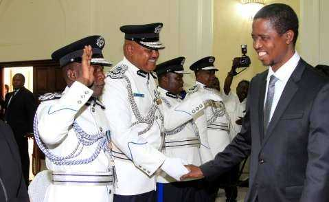 President Edgar Lungu greets the Swearing in Ceremony looking on is Mr Auxensio Daka Comissioner of Police Muchinga Province,and Mr Stanslous Agrippa Mukuka Chewe as Commissioner of Police Northern Province at Statehouse on Thursday 19-02-2015