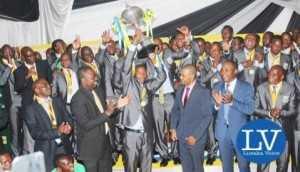 ZESCO captain- Jacob Banda lifting the trophy   - Image Credit - Jean Mandela